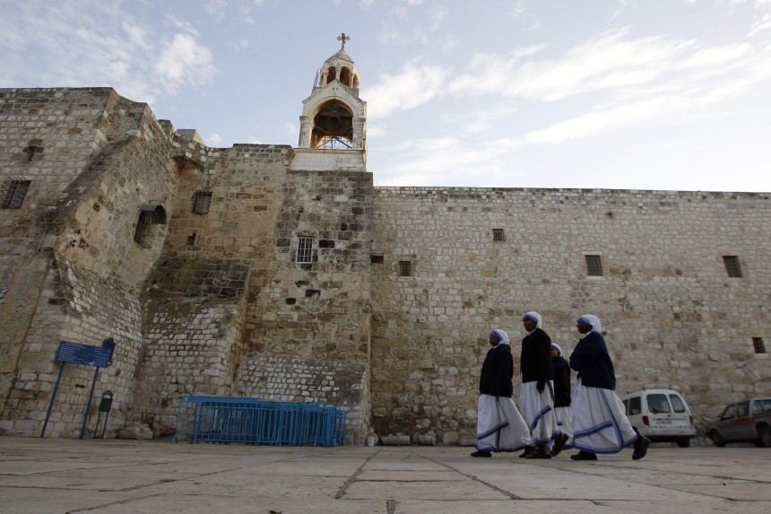 Nuns walk outside the Church of the Nativity in Bethlehem