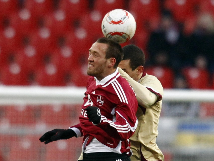 Schieber of FC Nuremberg is challenged by Pogatetz of Hanover 96 during their German Bundesliga first division soccer match in Nuremberg
