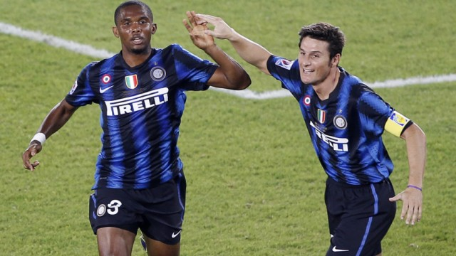 Eto'o of Italy's Inter Milan celebrates with Zanetti after scoring a goal against DR Congo's TP Mazembe during their Club World Cup final soccer match at Zayed Sports City in Abu Dhabi