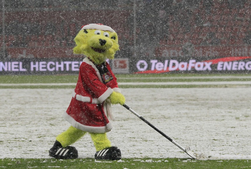 The mascot of Bayer Leverkusen shovels snow during half time of his team's German first division Bundesliga soccer match against SC Freiburg in Leverkusen