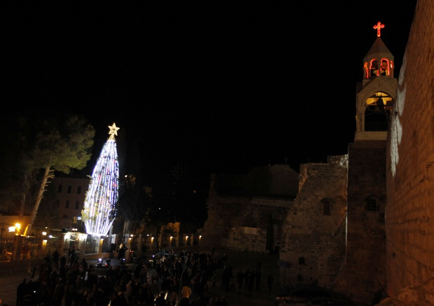 The Church of the Nativity is seen as people attend the annual lighting ceremony of a Christmas tree in Bethlehem