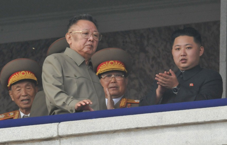 North Korean leader Kim Jong-il walks in front of his youngest son Kim Jong-un as they watch a parade to commemorate the 65th anniversary of the founding of the Workers' Party of Korea in Pyongyang