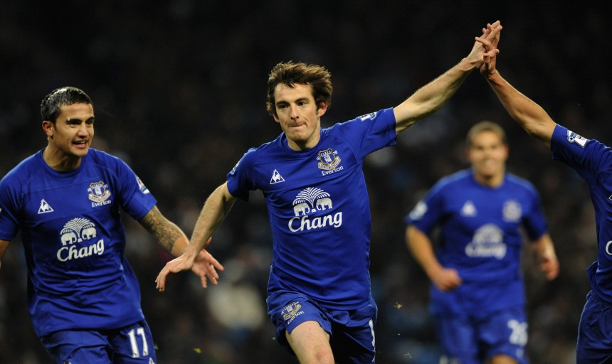 Everton's Baines celebrates scoring with teammates against Manchester City during their English Premier League soccer match in Manchester