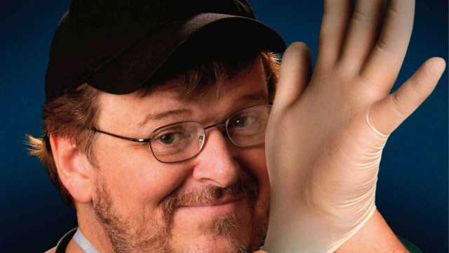 Documentary filmmaker Michael Moore is shown on the poster for his new film 'Sicko'
