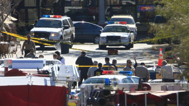 Law enforcement personnel work a crime scene where U.S Representative Gabrielle Giffords (D-AZ) was shot along with others at a Safeway in Tucson, Arizona