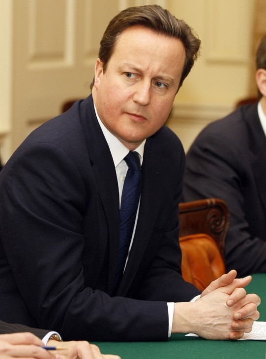 Britain's Prime Minister, David Cameron sits opposite China's Vice Premier Li Keqiang during a round table discussion with at Downing Street, in London