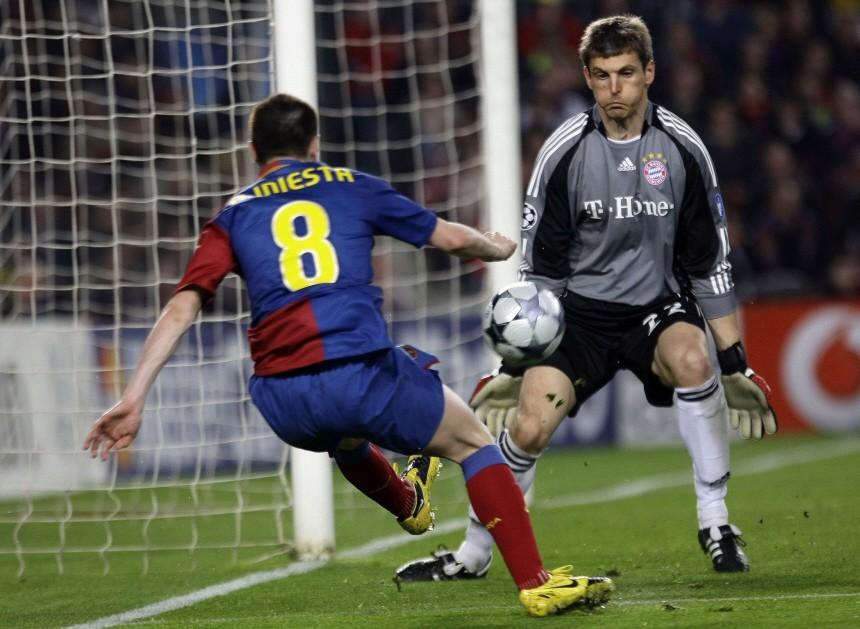 Bayern Munich's goalkeeper Butt tries to save a shot from Barcelona's Iniesta during their Champions League quarter-final, first-leg soccer match