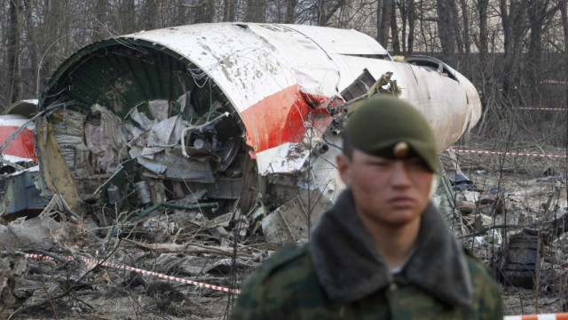 File photo of Russian serviceman standing guard near part of the wreckage of a Polish government Tupolev Tu-154 aircraft that crashed near Smolensk airport