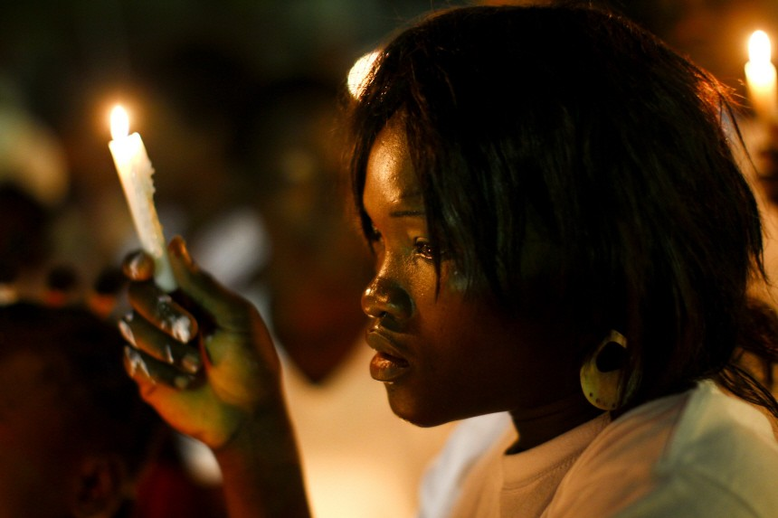 Haitian takes part in a vigil in honor of quake victims in Port-au-Prince