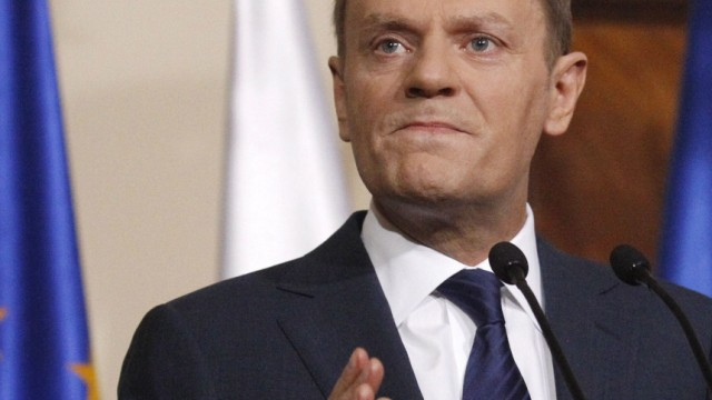 Poland's Prime Minister Donald Tusk speaks to the media during a news conference in Warsaw