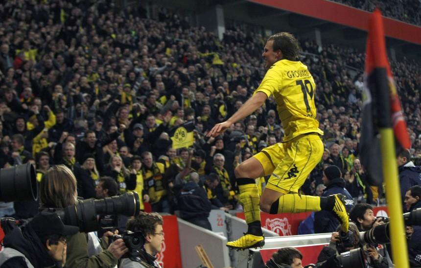 Borussia Dortmund's Grosskreutz celebrates a goal against Bayer Leverkusen during their soccer match in Leverkusen