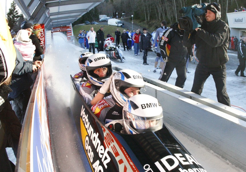 Germany's Florschuetz and his team mates Listner, Kuske and Barucha reach the finish area after the second run of the Bobsleigh and Skeleton World Cup competition in Igls