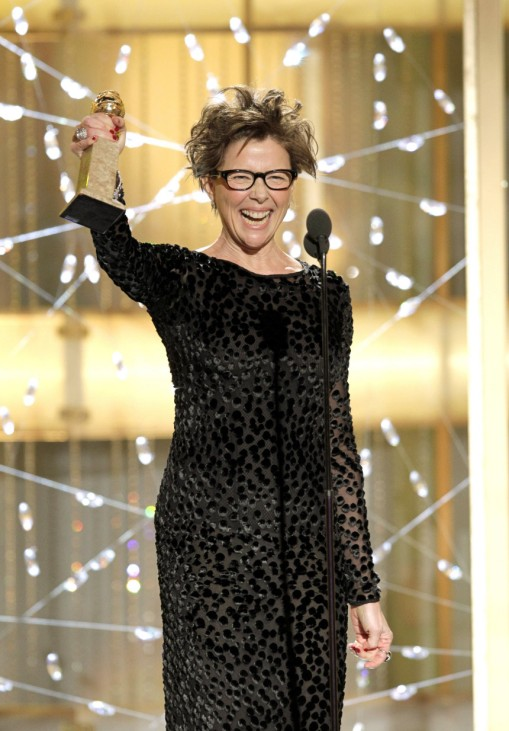Annette Benning accepts her award for best actress in a motion picture comedy or musical for 'The Kids Are All Right' at the 68th annual Golden Globes Awards in Beverly Hills
