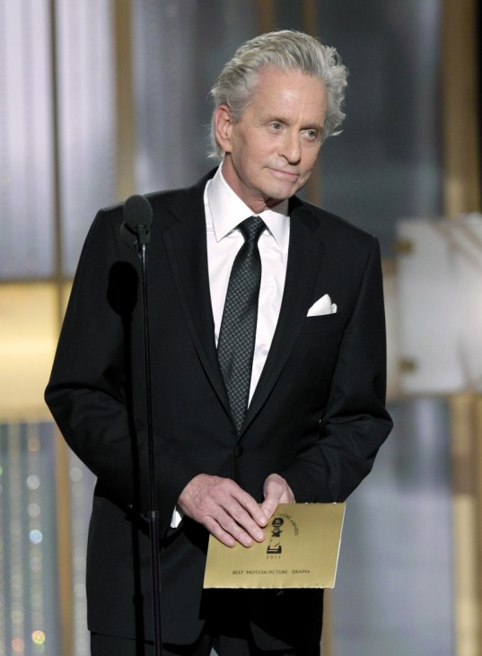 Actor Michael Douglas listens to a standing ovation as he comes on stage to present an award at the 68th annual Golden Globes Awards in Beverly Hills