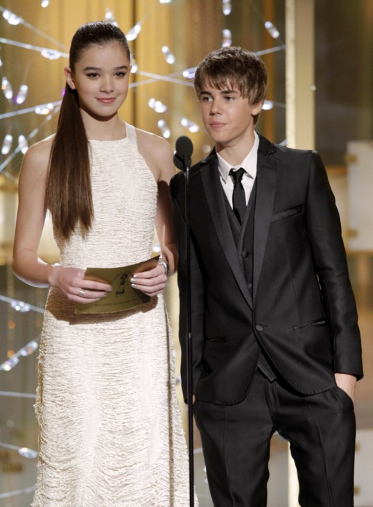 Presenters Hailee Steinfeld from 'True Grit' and singer Justin Bieber stand on stage at the 68th annual Golden Globes Awards in Beverly Hills