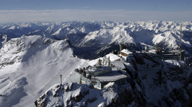 The summit cross on Germany's highest mountain Zugspitze is pictured in front of the panorama of the Austrian Alps near Garmisch-Partenkirchen