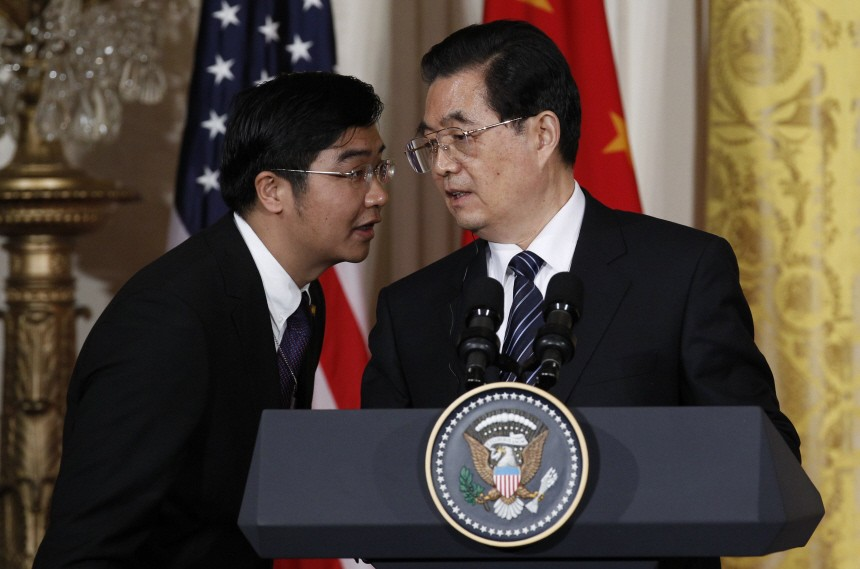 China's President Hu Jintao has his translator repeat a question in Chinese, concerning human rights, during his joint news conference in Washington
