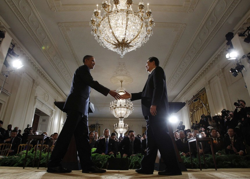 U.S. President Barack Obama shakes hands with Chinese President Hu Jintao after a joint news conference in the East Room at the White House in Washington