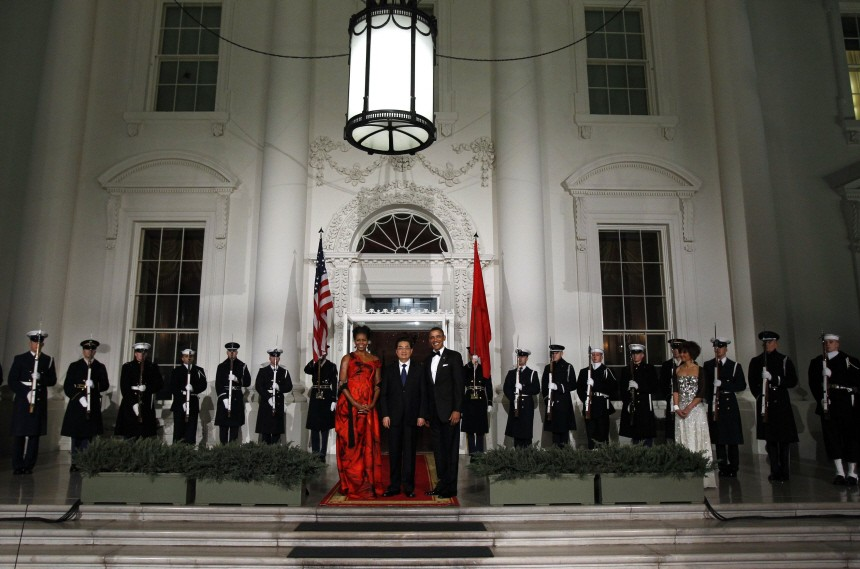 U.S. President Obama and first lady Michelle greet China's President Hu as he arrives for a State Dinner in his honor at the White House in Washington