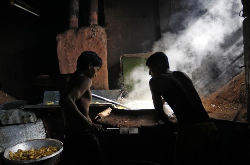 Employees work inside a banana chips factory in Mumbai