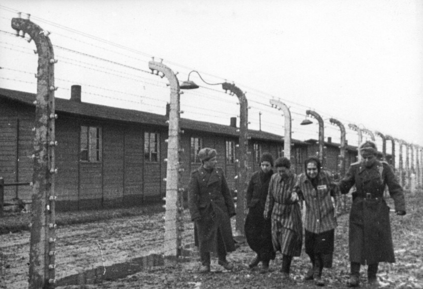 Archive photograph shows Soviet soldiers with some of the prisoners they liberated in Auschwitz II-Birkenau