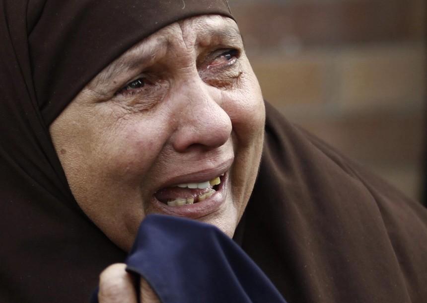 A relative of Gharib Abdelaziz Abdellatif cries during his funeral in the port city in Suez