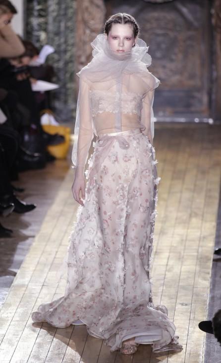 A model presents a creation by Italian designers Maria Grazia Chiuri and Pier Paolo Piccioli for Valentino as part of their Haute Couture Spring-Summer 2011 fashion show in Paris
