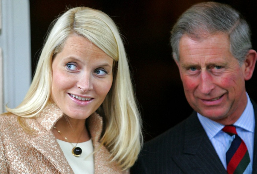 Norway's Crown Princess Mette Marit is greeted by Britain's Prince Charles at Clarence House in London