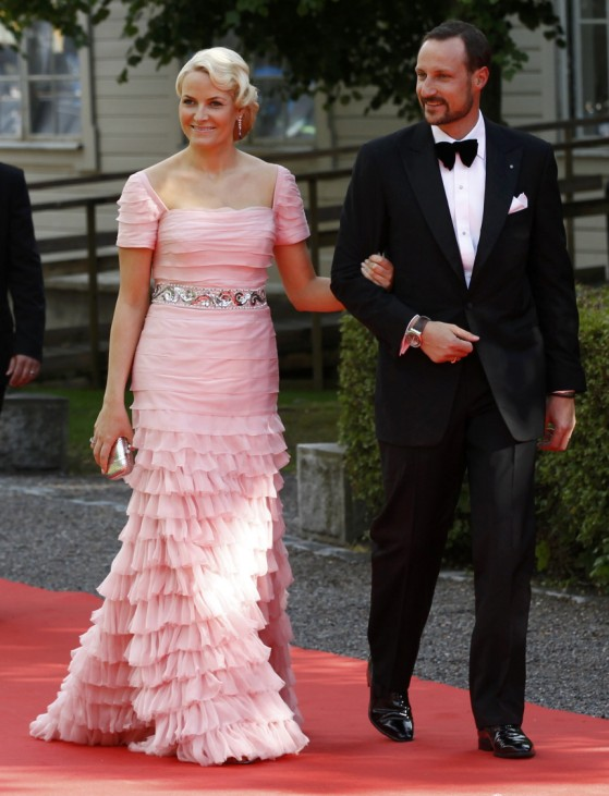 Norway's Crown Prince Haakon and wife Crown Princess Mette-Marit arrive for a Government dinner at the Eric Ericson Hall in Skeppsholmen