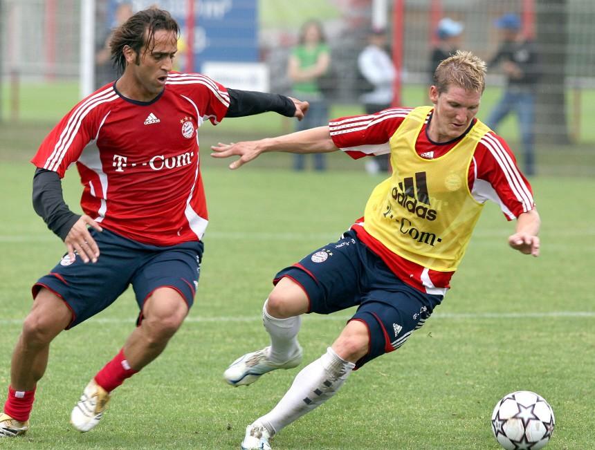 Ali Karimi und Bastian Schweinsteiger