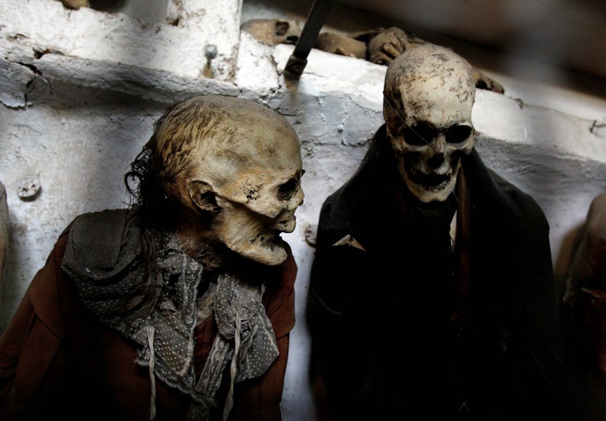 Fully clothed human remains are displayed at the Capuchin Catacombs in Palermo