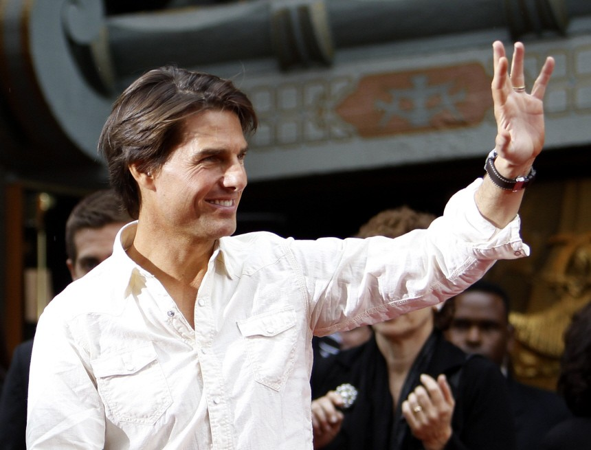 Cruise waves as he arrives at the hand and footprints ceremony for producer Jerry Bruckheimer at the Grauman's Chinese theatre in Hollywood