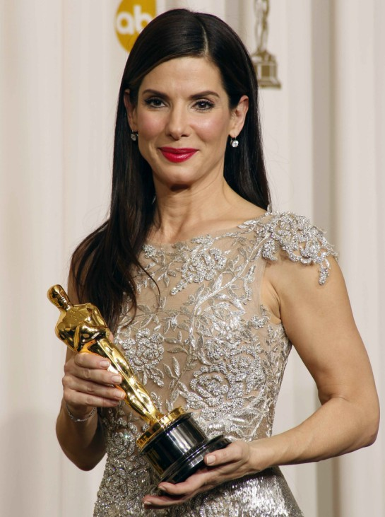 Best actress winner Sandra Bullock from the film The Blind Side displays her Oscar at the 82nd Academy Awards in Hollywood