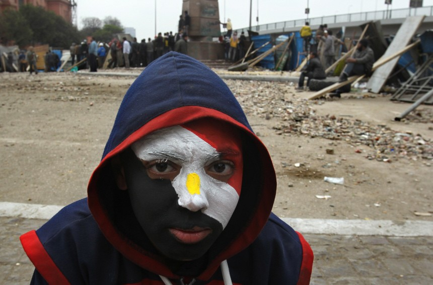 Anti Mubarak young activist with painted face in tahrir Square ba