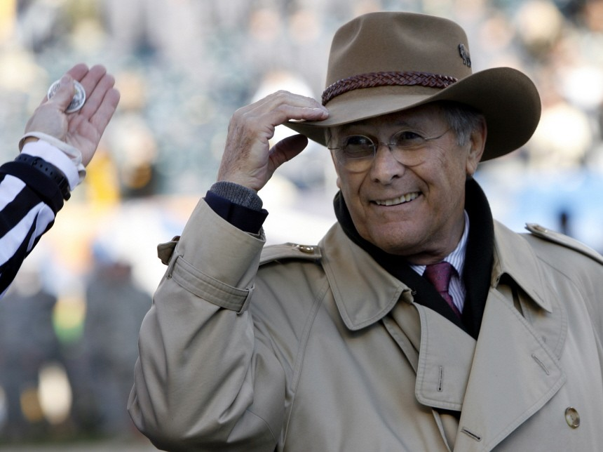Outgoing U.S. Secretary of Defense Donald Rumsfeld acknowledges the crowd before the coin toss from the field before the start of the 107th Army versus Navy football game in Philadelphia
