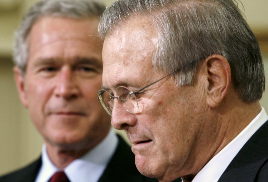 US President Bush looks toward Secretary of Defense Rumsfeld in the Oval Office in Washington