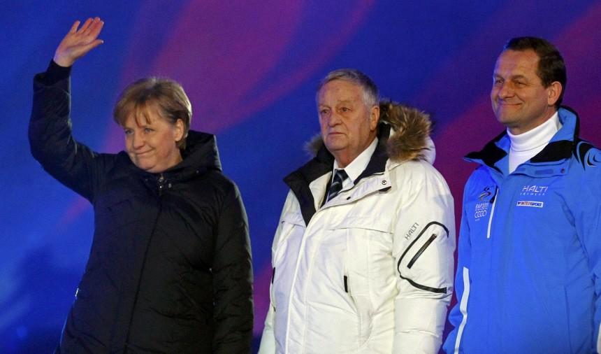 German Chancellor Merkel waves hand next to Swiss FIS president Kasper and German ski federation President Hoermann during the opening ceremony of the Alpine Ski World Championship in Garmisch-Partenkirchen