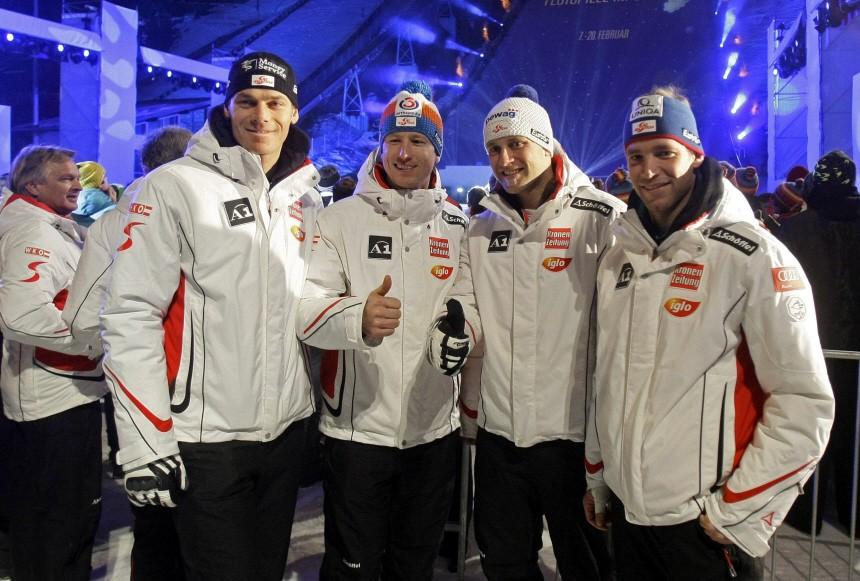 Austrian skiers Walchhofer, Reichelt, Baumann and Raich pose during the opening ceremony of the Alpine Ski World Championship in Garmisch-Partenkirchen