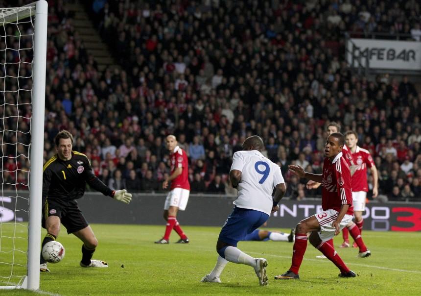 England 's Darren Bent scores past Denmark's Thomas Sorensen during their international friendly soccer match at the Parken Stadium, in Copenhagen