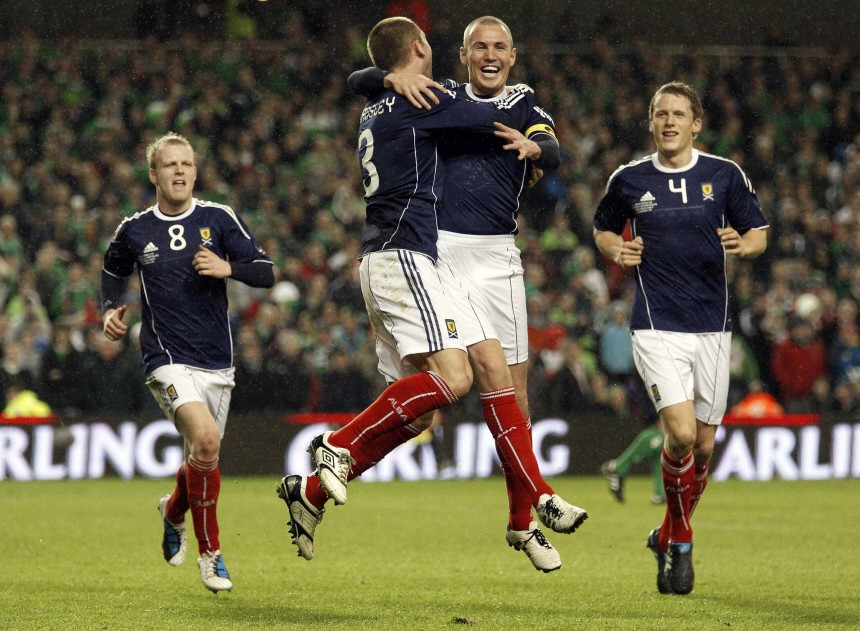 Scotland's Miller celebrates with his teammates after scoring against Northern Ireland during their Nations Cup soccer match in Dublin