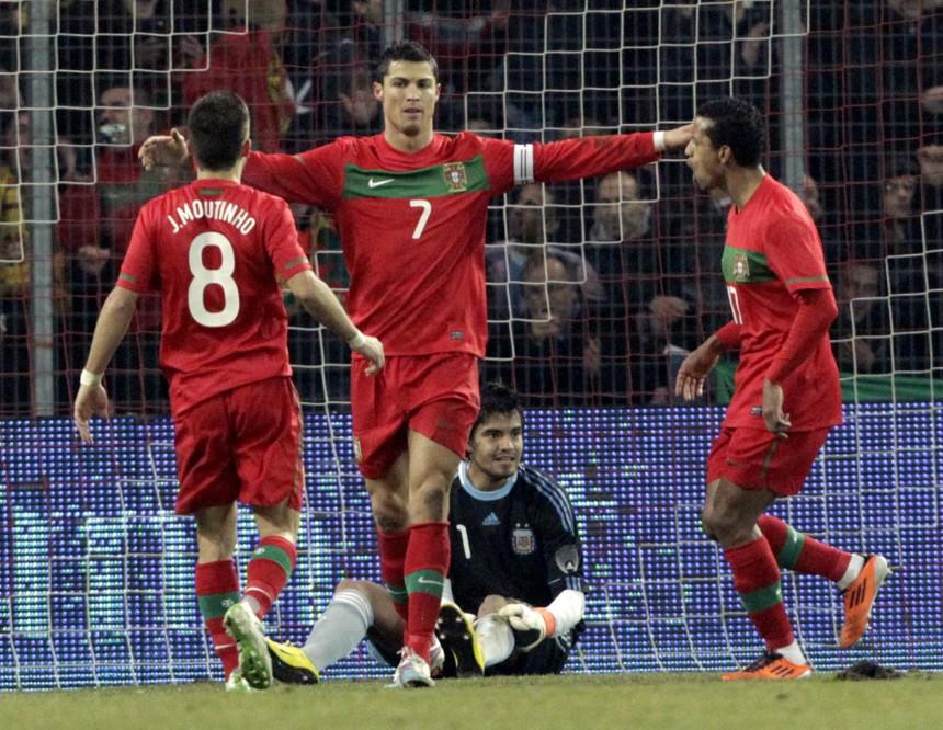 Portugal's Ronaldo scores a goal against Argentina's goalkeeper Romero during their international friendly soccer match at the Stade de Geneve in Geneva