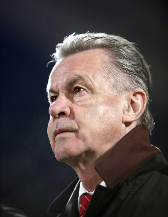 Switzerland's national team coach Hitzfeld listens to the national anthems at Ta'Qali National Stadium