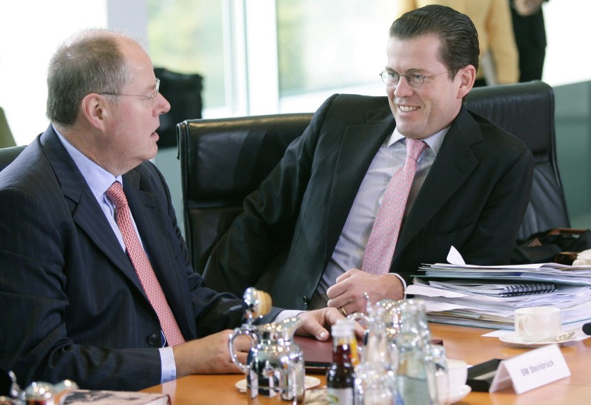 German Economy Minister Guttenberg talks to Finance Minister Steinbrueck before cabinet meeting in Berlin