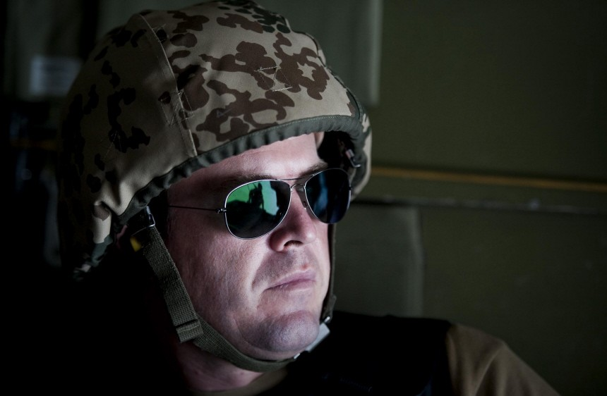 German Defence Minister Karl-Theodor zu Guttenberg sits in a helicopter on his way to Kunduz