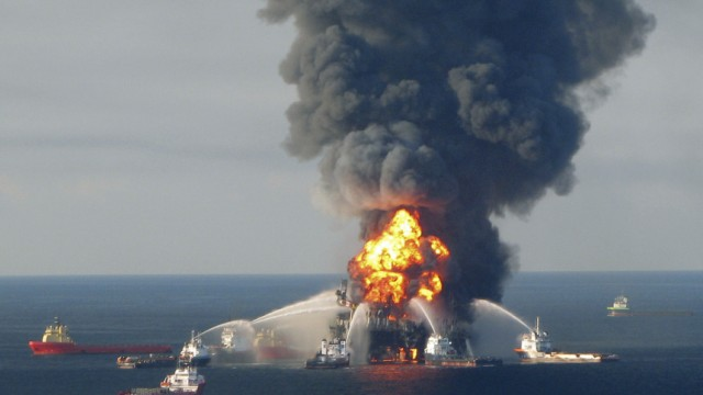 File photo of fire boat response crews battling the blazing remnants of the off shore oil rig Deepwater Horizon, off Louisiana