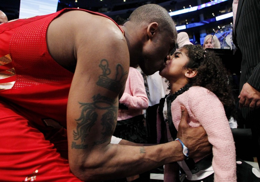 West All Star Bryant of the Lakers kisses his daughter Gianna after the NBA All-Star basketball game in Los Angeles