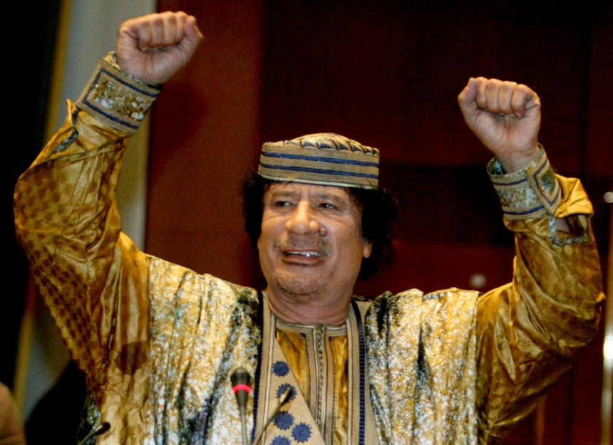 Libyan leader Muammar Gaddafi gestures as he addresses an Africa Union gathering in his hometown of Sirte
