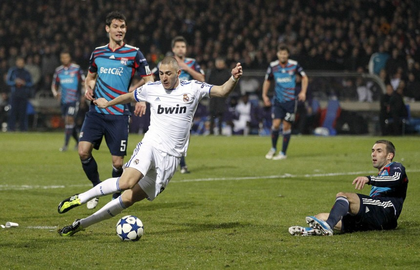 Benzema of Real Madrid shoots to score against Olympique Lyon during their Champions League soccer match in Lyon