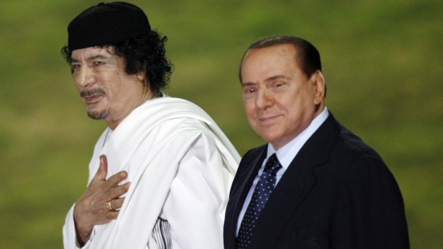 File photo of Berlusconi and Gaddafi in Rome