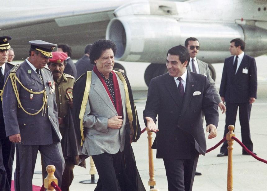 File photo of Tunisian President Zine Al-Abdine Ben Ali welcoming Libyan leader Muammar Gaddafi upon his arrival at Tunis airport